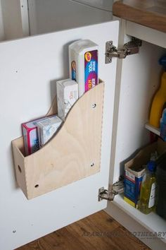 Ikea kitchen storage solutions Knuff magazine files. I have two of these empty from a clear out, now I know what to do with them :) will also do the pan lid bars.  The shelf inserts are a brilliant idea, wouldn't be without them in my kitchen.
