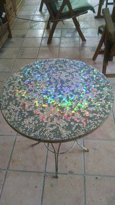 I made a mosaic table top with broken CDs! Completing it before Christmas is my . I made a mosaic table top with broken CDs! Completing it before Christmas is my little present for me. Cd Mosaic, Mosaic Garden, Mosaic Crafts, Mosaic Projects, Mosaic Mirrors, Mosaic Ideas, Craft Projects, At Home Projects, Craft Ideas