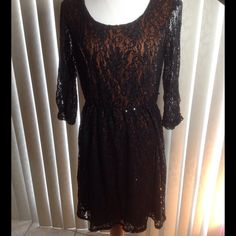 Vintage Lace Dress Vintage black sequins lace dress with an brownish orange lining.  Sleeves are unlined and 3/4 long. Gathered stretch waist.  Measurements laying flat: Bust 18 inches, Waist 15 inches unstretched, Hips 26 inches Runs Small(PB1) My Michelle Dresses Mini