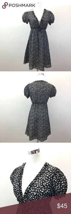 """🆒🆕SALE Joie $198 Polka Dot Black Silk Dress Joie $198 Black White Dot Silk Empire Waist Puff Sleeve Boho Ruffle Dress  Condition: ExcellentSilk/Cotton blend Fully lined in silk Ruffle edge detail around collar and neckline Elastic sleeve bands on puff-style sleeves 4 hook/eye bottom of the neckline closure Flattering and comfortable silhouette  Approximate measurements taken flat: Bust (underarm to underarm): 20"""" Waist: 17"""" Length (top of the shoulder to hem): 34.5""""✅PRICE IS ALREADY…"""