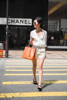 Nicole Warne in Witchery top, vintage shorts, Prada bag, Tabitha Simmons flats - In Hong Kong. (August 2014)