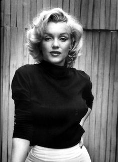 """Alfred Eisenstaedt: Marilyn Monroe, 1953    """"When I photographed Marilyn Monroe, I mixed up my cameras - one had black-and-white film, the other color. I took many pictures. Only two color ones came out all right. My favorite picture of Marilyn hangs always on the wall in my office. It was taken on the little patio of her Hollywood house."""" - Alfred Eisenstaedt"""
