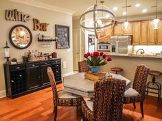 Traditional Dining Room with Hardwood floors, 70 Jupe Hexagon Table, RCH Gifts Wood Cutout, Seagrass Side Chair, High ceiling Traditional Dining Rooms, Florida Living, Wood Cutouts, Ceiling Pendant, Decorating Your Home, Decorating Ideas, Side Chairs, Dining Area, Hardwood Floors