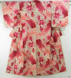 This is a charming Meisen Kimono with vibrant magnolia pattern, which is woven