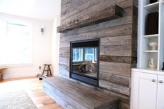 Modern barnwood fireplace Not sure how practical this would be for a wood fireplace, but I love the look