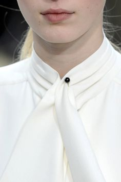 White Shirt collar detail - neck tie, tucks around the collar & minimal pin feature; chic fashion design details