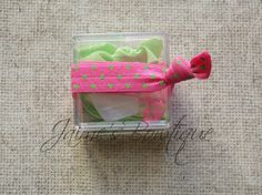 Soft stretch hair ties with tie keeper case.