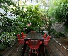 Deck Ideas with screening and planting plus wire chairs
