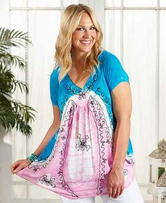 This Women's Plus Tie-Dye Tunic Top will keep you cool and looking pretty on even the hottest days. Breezy and lightweight, the pullover tunic features a beautiful tie-dye design accented with stitchery and sequins. It has a V-neckline and short sleeves