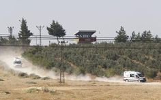 Turkey has joined the fight against ISIS. Ambulances drive away from a border post that was attacked.