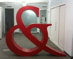 Taylor & Ives commissioned Art Director and sculptor Dan Caspescha to build a human-size sculpture of the T ampersand. The structure was constructed from plywood and bent wood, coated with bondo, and given a bright red lacquer and clear finish. Typography Love, Typography Letters, Ampersand Sign, Letter Symbols, Bent Wood, Letters And Numbers, Graphic Design Inspiration, Design Art, Sculpture