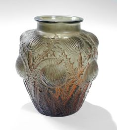 R. LALIQUE DOMREMY VASE: Topaz glass in a thistle design with orange patinated finish. Impressed R. Lalique, inscribed Lalique France. Ca. 1926.