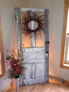 love the idea of having a light behind it to illuminate the door decor