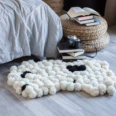 Make this stylish and chic pompom rug. Whether you use it as a rug, wall hanging or drape it over a chair, it will make a statement.