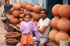 A pot-seller with his daughter, India - Found via Buzzfeed
