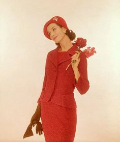 Wool tweed suit in two shades of red, with hip pockets and two button jacket, 1959    Photo by William Bell