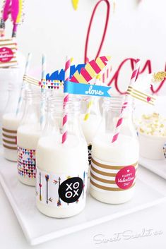Boho Indian Valentine's Day  party milk bottles! See more party planning ideas at CatchMyParty.com