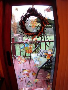 kids enjoy putting cling on decorations on the glass door