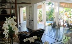 Amazing deck/patio with pool, outdoor curtains and bamboo roman shades.