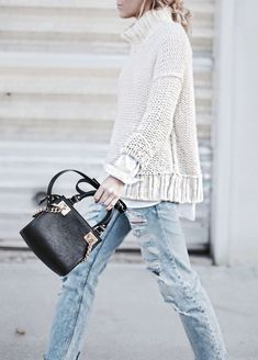 distressed boyfriend jeans, long sleeve layers with mock turtle neck sweater, great purse