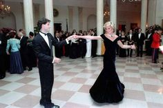 Princess Diana dancing with John Travolta in the entrance hall at the White House. | 29 Pictures Of '80s Pop Culture At The Reagan White House