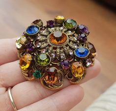 SO EXQUISITE IN DETAIL IN AN ANTIQUE LOOK GOLD TONE CZECH STYLE FILIGREE SURROUND.WITH LARGE AMBER COLOURED FACETED GLASS RHINESTONE TO THE CENTRE.AND MULTI COLOURED GLASS RHINESTONES SET THROUGHOUT THIS BEAUTIFUL BROOCH.IN CIRCULAR AND OVAL SHAPES IN GRADUATING SIZES. | eBay!