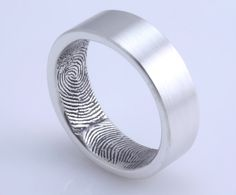 custom fingerprint wedding band. how sweet for a husband to have his wives print inside!