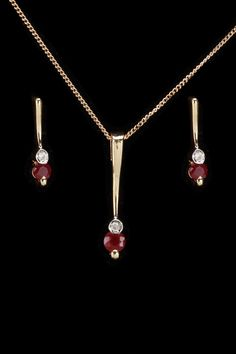 gold blowout 10k Gold, Diamond  Ruby Necklace  Earrings Set -