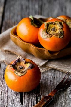 readbetweenthegrinds: Persimmons, what a beautiful color.