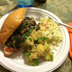"""Portobello """"steak"""" sandwiches with spicy potatoe salad and cole slaw."""