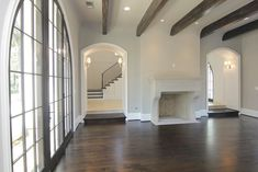 Secondary view of the Living Room   (22'x15 Flanking the Foyer, the Living Room features hardwood floors and an impressive masonry fireplace with limestone mantle.  Custom Palladian-style doors allow wonderful views of both the front & back gardens..