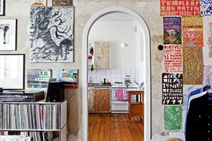 adore the organization of the art and the door way-- would love like an artsy room with record, a record player, a dj station with a computer, a shelf of music theory and art history etc, keyboard, painting station, and gorgeous art like this all over the walls.