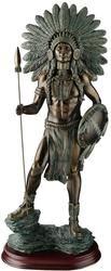 Finely sculpted in the style of Russell and Remington, this idealized Native American warrior stands as a proud testament to the bravery of many nations. Showcasing the artist's eye for detail, from feathered headdress to majestic spear, this foot-and-a-half tall sculpt is captured in quality designer resin with a faux verdigris finish and a wooden base. This sculpture is inspired by traditional southwest art but is not an Indian product or the product of a particular Indian tribe or…