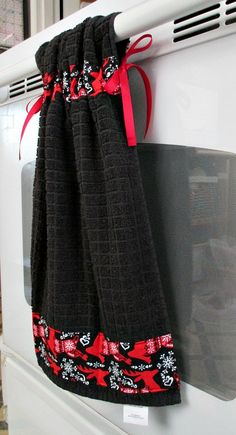 Tie Top Towels-Black Kitchen towel accented with Red Reindeer; attaches to stove handle by allwrappedupandmore on Etsy