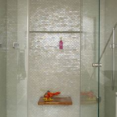 Sparklingly modern bathroom - irridescent Cream Brick Shell Tiles in shower.  https://www.subwaytileoutlet.com/products/Cream-Brick-Pearl-Shell-Tile.html#.VOUFp_nF-1U