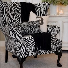 zebra print chair  http://ZebraPrintStuff.com  This is similar to the one we bought for her room.  Ours is a bit smaller in scale.