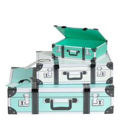 Turquoise. Suitcase-shaped cardboard storage boxes with a lid, magnetic fastener, and matching luggage tag. Size 1 1/4 x 3 1/4 x 4 1/4 in., 2 x 5 x 7 in.,