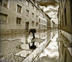 The sky's the limit: A labourer lays a reflection on the road    Erik Johansson