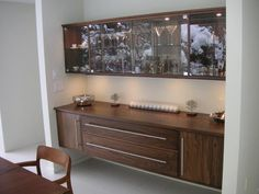 Although this doesn't fit into my plan, I need to pin this! This is a striking look. Has a little flavor of an early sideboard, but has a contemporary feel with those AMAZING long drawer and cabinet pulls. Walnut Sideboard, Bar Ideas, Furniture Inspiration, Dividers, Wood Working, Contemporary, Modern, Cupboard, Snug