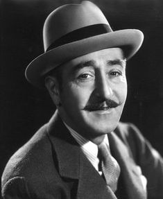 Adolph Menjou (1890-1963), c. 1935. On IMDB, his first listing as an actor is in 1914 and the last is in 1961. He made a very successful transition from silents to talkies -- truly a distinguished career.