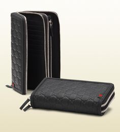 Gucci double zip around wallet (exotic print not shown) $S5,380