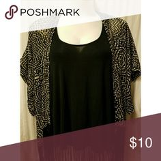 Black and white short sleeve cardigan w/tassels. Extremely light weight. Won't keep you warm but it sure is cute and flowy! Tops