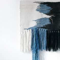 Beautiful handmade wallhanging. Unique fibre art - nursery wall decoration. Tapestry handwoven on a lap loom. Natural flax warp. Natural wool and cotton weft. Wooden dowel to hang. Handwoven in Berlin. Colors: white, black and cobalt blue. My textiles are woven only with good-quality
