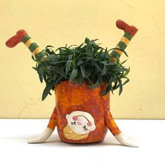 Ceramic Planter Ceramic Pot Funny Girl Orange Yellow Green - A funny ceramic girl pot is ideal for indoor and outdoor planters The pot was thrown on the potter - Ceramic Planters, Ceramic Vase, Ceramic Pottery, Ceramic Shop, Ceramic Flower Pots, Clay Projects, Clay Crafts, Cerámica Ideas, The Potter's Wheel