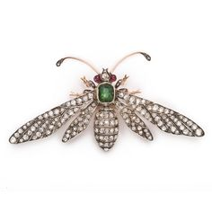 Diamond and Emerald Antique French Wasp Brooch by Fontanasee larger image    Crown rose diamond and emerald wasp brooch set in silver and gold.    by Fontana  French, ca. 1875  Width: 3 inches.