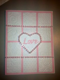 wedding card made with various cuttlebug embossing folders which I then cut into squares. I also embellished with small self adhesive pearls.  Pink background because I know the bride.  If i knew the  groom I would use a blue background.