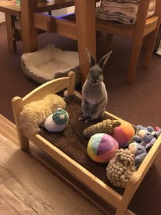 Aww, super cute bunny and bed filled with toys.