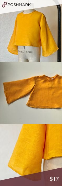 Mustard Yellow Toddler Bell Sleeve Crop Top Retrotot is my personal brand. I designed and made these in LA. This adorable crop top is made with linen fabric and is perfect for spring and summer days. Your little's cute baby belly will poke out and make your heart melt. The bell sleeves sends these cute shirts above and beyond cuteness! Retrotot Shirts & Tops Blouses