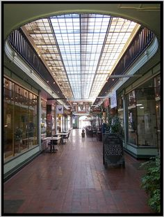 The Paddock Arcade is a 19th century shopping mall located in Watertown, New York. Built in 1850, it is the second oldest covered shopping mall in the United States. opened in 1850, it carries the distinction of being the country's oldest, continuously operating covered shopping mall. The Paddock Arcade was listed on theNational Register of Historic Places in 1976. Built: 1850 Architect: Otis Wheelock Architectural style:Gothic Revival NRHP Reference#: 76001224