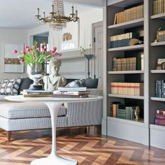 Glimmer of Gray - Design Chic- love seeing the books in the bookcase and the herringbone wood floors, gorgeous! Grey Bookshelves, Built In Bookcase, Painted Bookcases, Grey Shelves, Gray Interior, Home Interior, My Living Room, Living Spaces, Herringbone Wood Floor